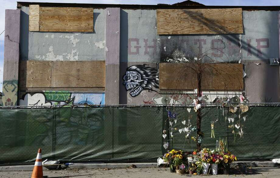 Flowers are left at a makeshift memorial outside  the Ghost Ship warehouse in Oakland to 36 partygoers who died there. Photo: Ben Margot / Ben Margot / Associated Press / Copyright 2017 The Associated Press. All rights reserved.