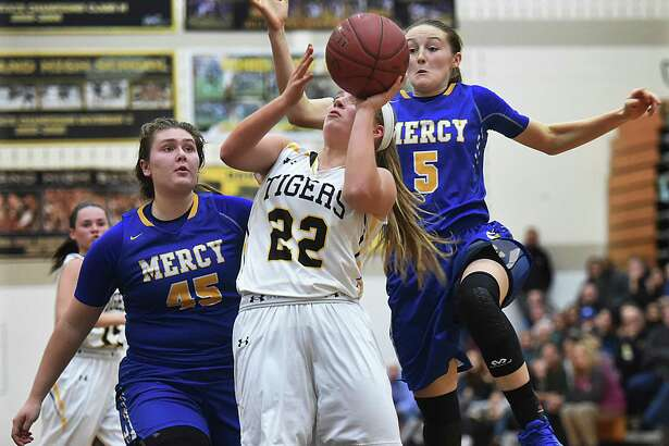 Hand's Gabby Egidio elevates to the hoop as Mercy's Meg Deville and Bella Santoro defend on Thursday.