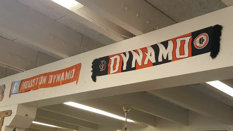 Dynamo scarves from every season decorate the walls at Soccer Time. After 31 years in business, the Pasadena soccer store is closing for good on Saturday. Photo: Corey Roepken