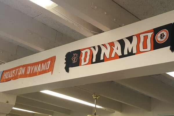 Dynamo scarves from every season decorate the walls at Soccer Time. After 31 years in business, the Pasadena soccer store is closing for good on Saturday.