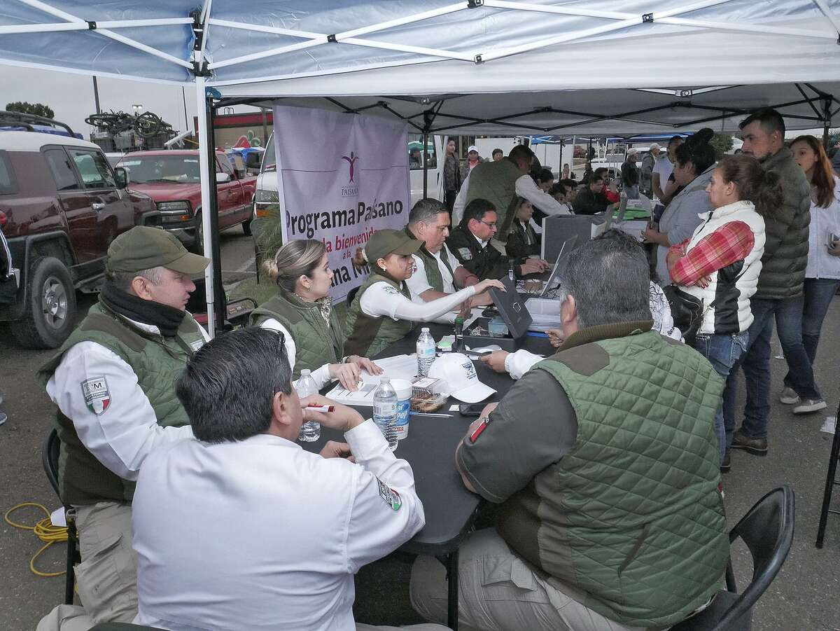 Mexican Immigration officials were on hand to assists Mexican Nationals with their vehicle and personal permits before heading home for the holdiays. The parking lot at the Walmart Store on the 5600 of San Bernardo Avenue was jam packed with vehicles as Mexican nationals (Paisanos) gathered there Wednesday, December 13, 2017, for the Paisano Caravan that will leave Laredo Thursday morning as they travel to their homes in Mexico. Mexican nationals from as far away as California, Indiana, Virginia, Colorado, Utah and Illinois were in line for the trip.