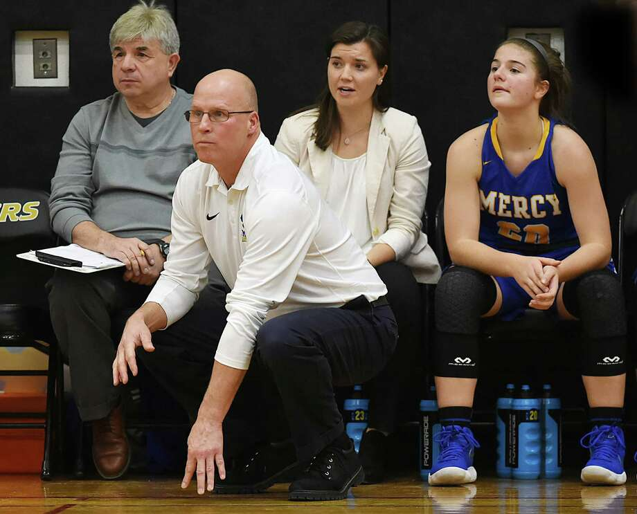 Mercy head coach Tim Kohsl on the sidelines against Hand, Thursday, Dec. 14, 2017, at Daniel Hand High School in Madison. Mercy won, 50-40. Photo: Catherine Avalone, Hearst Connecticut Media / New Haven Register