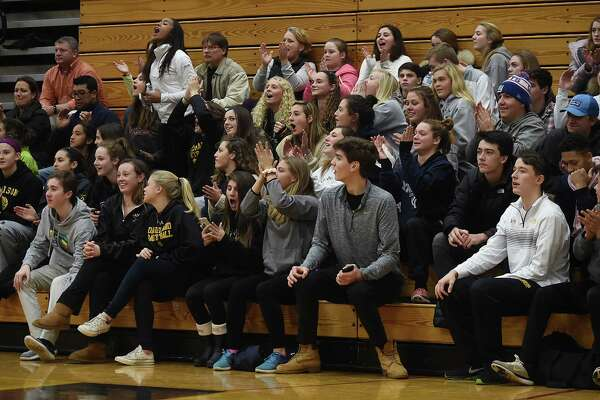 The Hand student section celebrates as the Tigers score against the visiting Tigers of Mercy-Middletown, Thursday, Dec. 14, 2017, at Daniel Hand High School in Madison. Mercy won, 50-40.