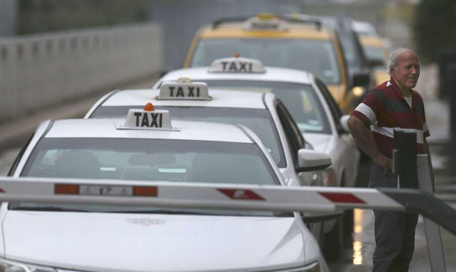 Taxi cabs line up Sept. 26, 2017, at the San Antonio International Airport. A San Antonio City Council panel referred to council for a vote next year a proposal to possibly put more cabs on the road. Photo: John Davenport /San Antonio Express-News / ©John Davenport/San Antonio Express-News