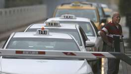 Taxi cabs line up Sept. 26, 2017, at the San Antonio International Airport. A San Antonio City Council panel referred to council for a vote next year a proposal to possibly put more cabs on the road.