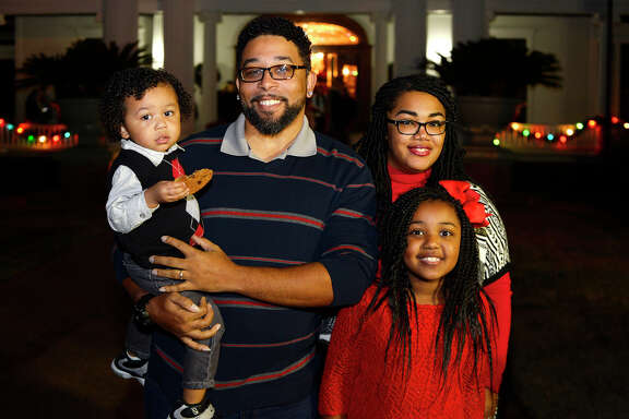 TJ and Shawntee Scott with children Caiden and Mackenzie at the McFaddin-Ward House Museum's egg nog open house on Thursday evening.  Photo taken Thursday 12/14/17 Ryan Pelham/The Enterprise
