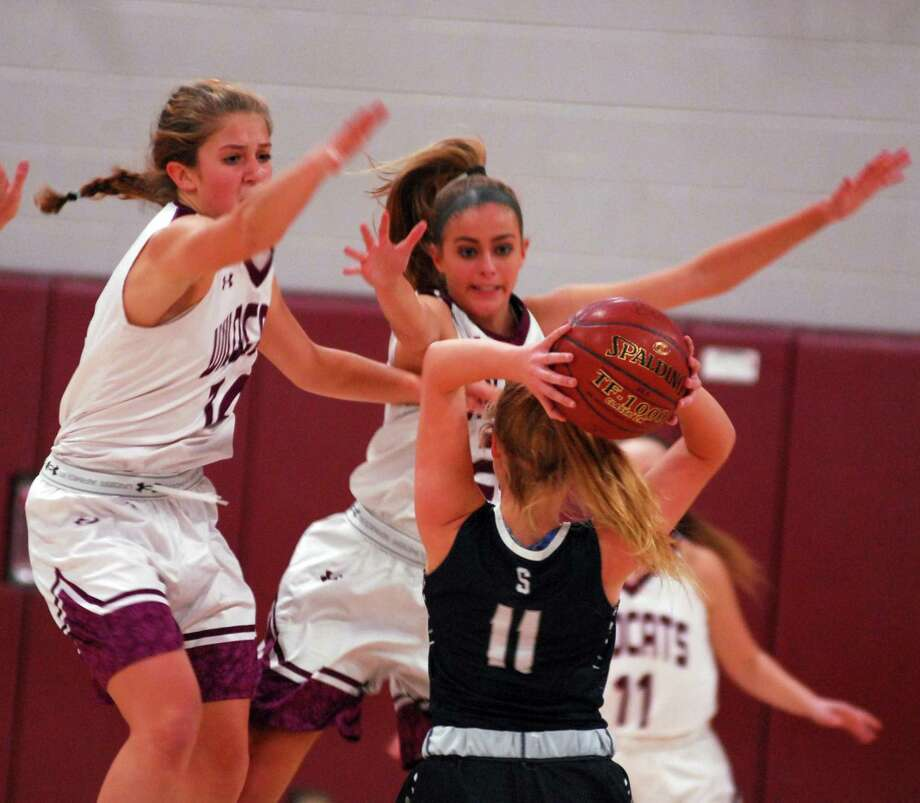 Staples' Elle Fair is defended by Bethel's Lily Daniels and Britney Roach during a game on Thursday. Photo: Ryan Lacey / Hearst Connecticut Media