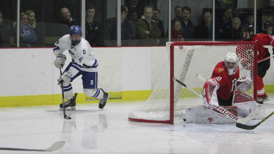 Darien's C.J. Hathaway was the team's leading scorer last season. Photo: Anthony E. Parelli / Hearst Connecticut Media / Darien News