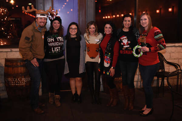 Young Professionals of Midland hosted a Ugly Sweater Christmas Mixer and toy drive to collect presents for children in the Buckner Home Dec. 14, 2017, at the Blue Door. James Durbin/Reporter-Telegram
