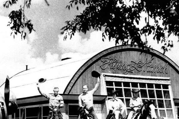 Wranglers gather in front of the pilots' lounge at the Flying L Ranch in 1948. When the Flying L opened in 1947, it had its own airport.