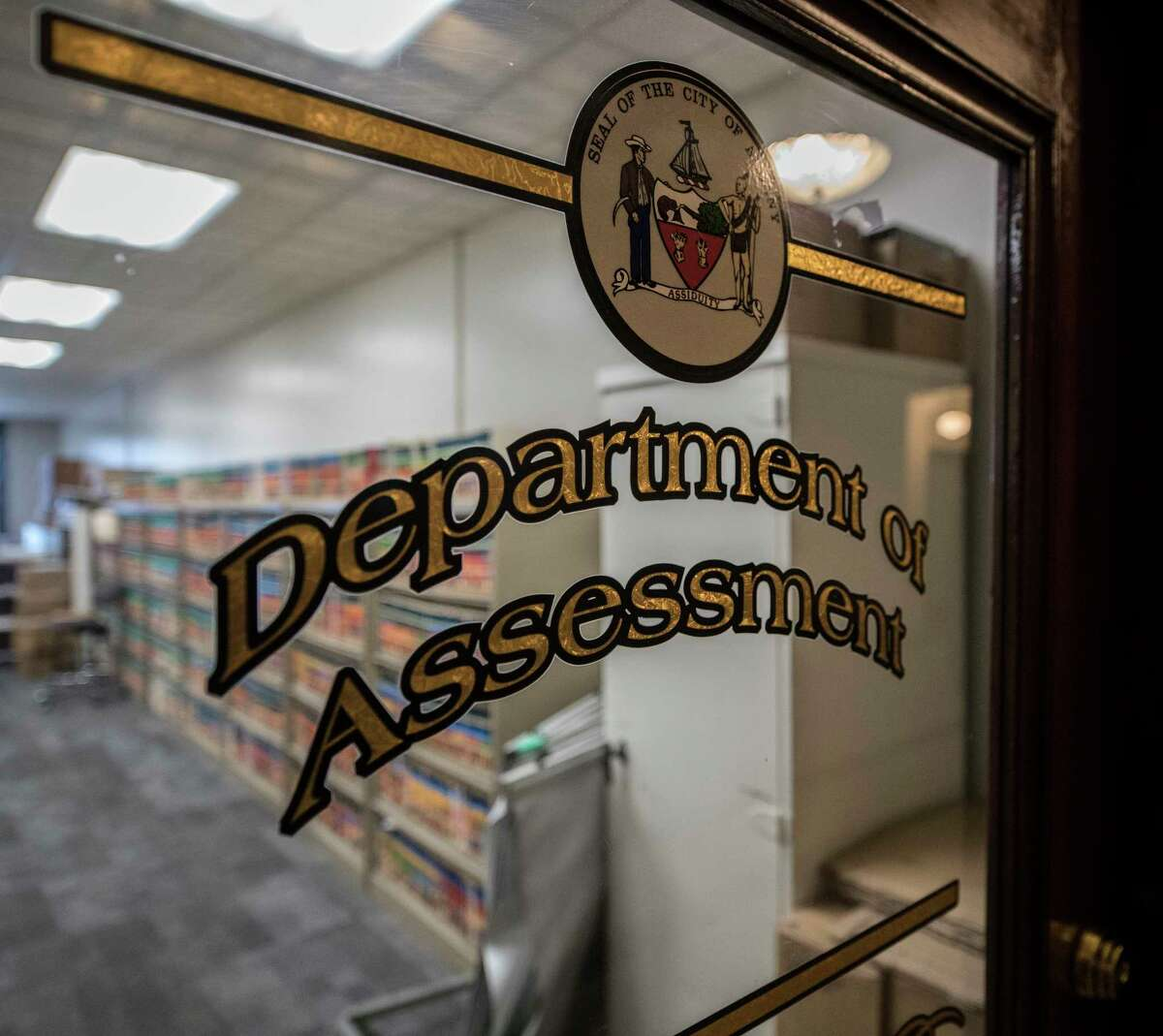 The logo on the door of the Department of Assessment in City Hall Thursday Dec 14, 2017 in Albany, N.Y. (Skip Dickstein/ Times Union)