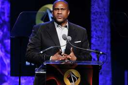 """FILE - In this April 27, 2016 file photo, Tavis Smiley appears at the 33rd annual ASCAP Pop Music Awards in Los Angeles. PBS says it has suspended distribution of Smiley's talk show after an independent investigation uncovered """"multiple, credible allegations"""" of misconduct by its host. (Photo by Rich Fury/Invision/AP, File) ORG XMIT: NYET672"""