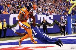 INDIANAPOLIS, IN - DECEMBER 14:  Cody Latimer #14 of the Denver Broncos makes a catch for a touchdown defended by D.J. White #37 of the Indianapolis Colts during the second half at Lucas Oil Stadium on December 14, 2017 in Indianapolis, Indiana.  (Photo by Joe Robbins/Getty Images) ORG XMIT: 700070804