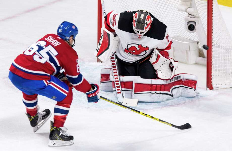 New Jersey Devils goaltender Cory Schneider deflects a shot from Montreal Canadiens' Andrew Shaw during the second period of an NHL hockey game, Thursday, Dec. 14, 2017 in Montreal. (Paul Chiasson/The Canadian Press via AP) ORG XMIT: PCH112 Photo: Paul Chiasson / The Canadian Press