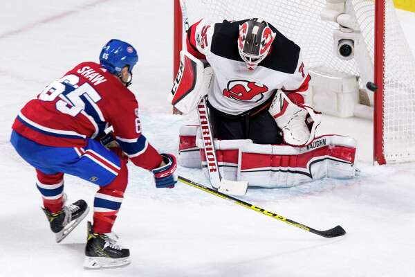 New Jersey Devils goaltender Cory Schneider deflects a shot from Montreal Canadiens' Andrew Shaw during the second period of an NHL hockey game, Thursday, Dec. 14, 2017 in Montreal. (Paul Chiasson/The Canadian Press via AP) ORG XMIT: PCH112