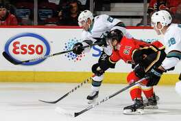 CALGARY, AB  DECEMBER 14, 2017: Joonas Donskoi #27 of the San Jose Sharks makes a pass in a game against the Calgary Flames at the Scotiabank Saddledome on Saturday night. (Photo by Brad Watson/NHLI via Getty Images)