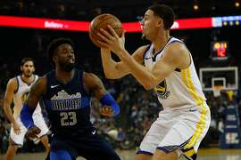 Klay Thompson #11 of the Golden State Warriors looks to shoot the ball during the first quarter of his NBA basketball game against the Dallas Mavericks at Oracle Arena in Oakland, Calif. on Thursday, Dec. 14, 2017.