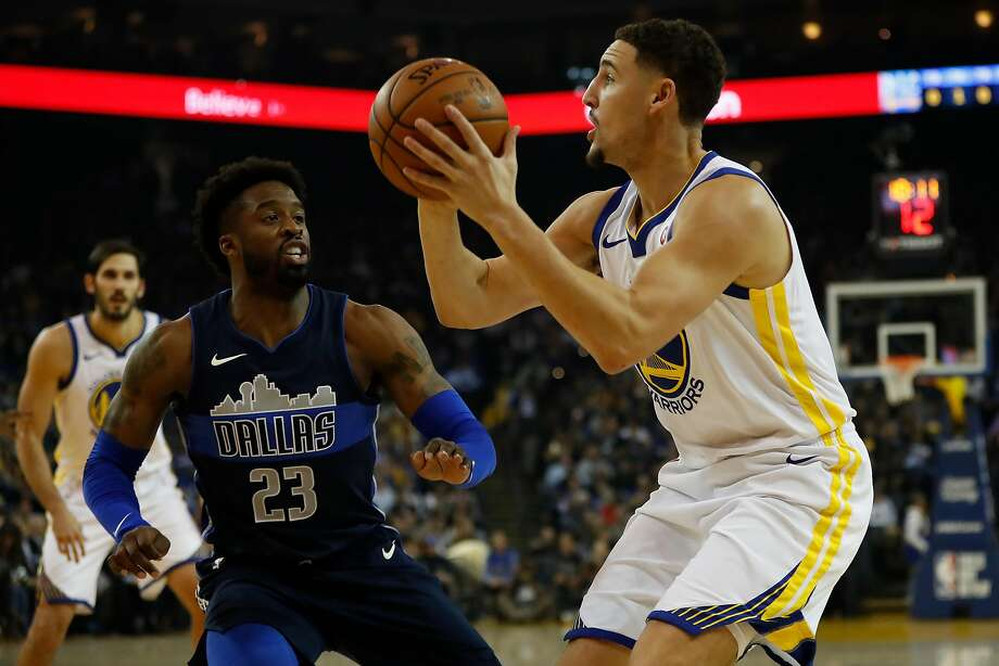 Klay Thompson #11 of the Golden State Warriors looks to shoot the ball during the first quarter of his NBA basketball game against the Dallas Mavericks at Oracle Arena in Oakland, Calif. on Thursday, Dec. 14, 2017. Photo: Stephen Lam, Special To The Chronicle