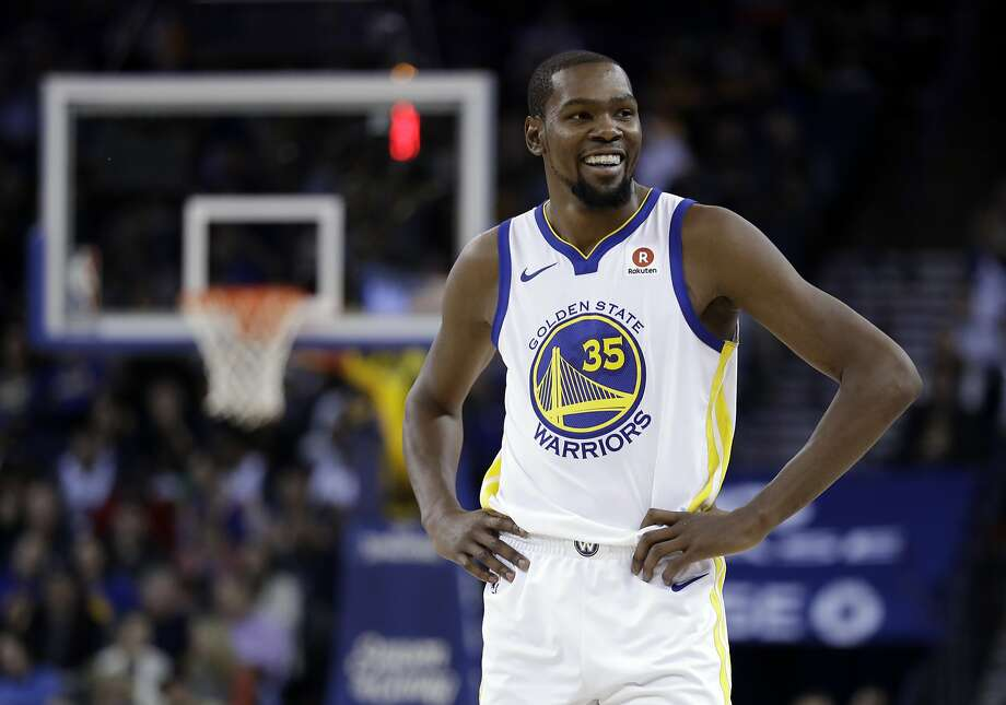 Golden State Warriors' Kevin Durant smiles during a break in play during the second half of an NBA basketball game against the Dallas Mavericks Thursday, Dec. 14, 2017, in Oakland, Calif. (AP Photo/Marcio Jose Sanchez) Photo: Marcio Jose Sanchez, Associated Press