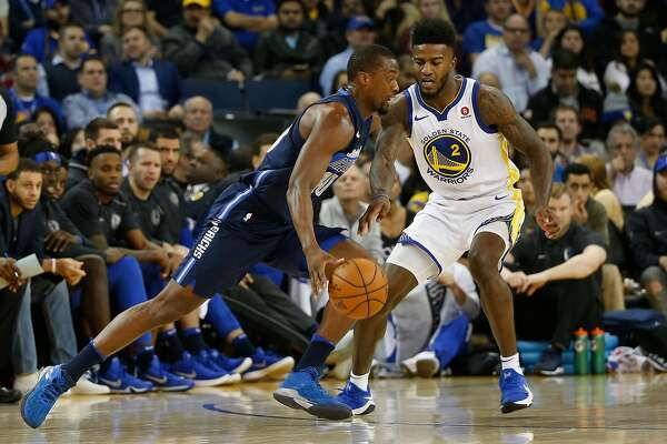 Harrison Barnes #40 of the Dallas Mavericks drives the ball as Jordan Bell #2 of the Golden State Warriors defends during the second quarter of their NBA basketball game at Oracle Arena in Oakland, Calif. on Thursday, Dec. 14, 2017.