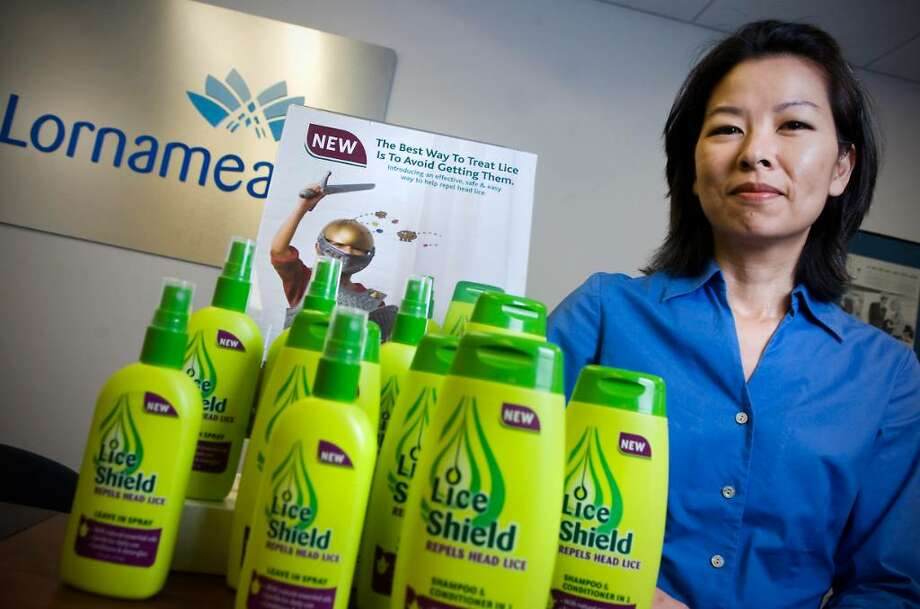 Karen Murabito, group brand director for Lornamead, with the company's product Lice Shield, repellent products for lice prevention,  in Stamford, Conn. on Tuesday, June 29 2010. Photo: Kathleen O'Rourke / Stamford Advocate