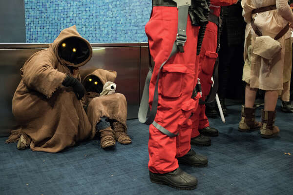 A mother and child dressed as Jawas take a moment during the premiere of Star Wars: The Last Jedi, at Cinerama on Thursday, Dec. 14, 2017.