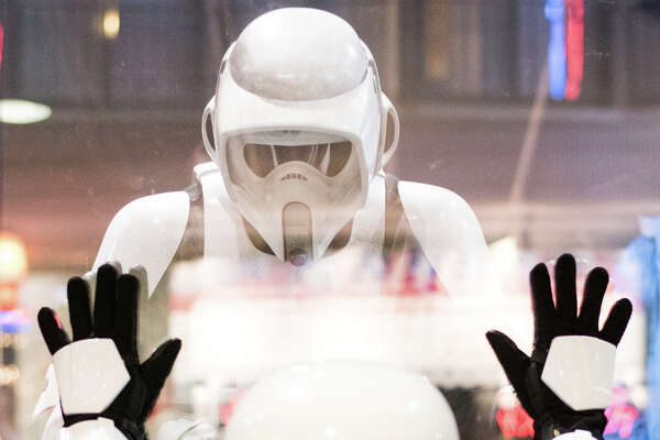 Two stormtroopers stare at each other through the window before the premiere of Star Wars: The Last Jedi, at Cinerama on Thursday, Dec. 14, 2017.