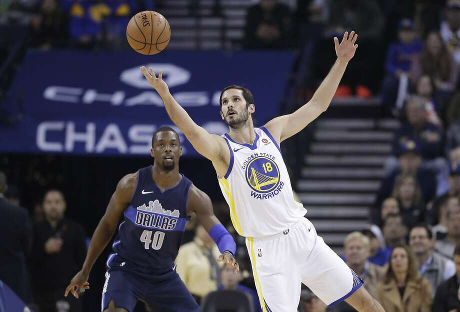 Golden State Warriors' Omri Casspi, right, grabs a pass next to Dallas Mavericks' Harrison Barnes (40) during the first half of an NBA basketball game Thursday, Dec. 14, 2017, in Oakland, Calif. (AP Photo/Marcio Jose Sanchez) Photo: Marcio Jose Sanchez, Associated Press