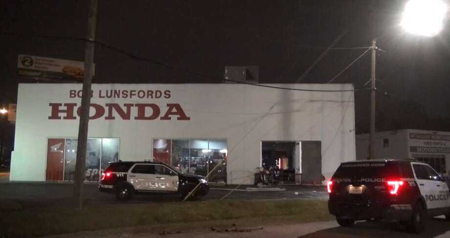 A group of thieves used a stolen truck to break into a north Houston Honda dealership early Friday morning, Houston police said. Police were dispatched around 4 a.m. to the dealership off Interstate 45 near Midland Drive after a tow truck driver saw a burglary in progress, police said. The thieves, police said, arrived in a stolen Ford pick-up truck before breaking one of the business's windows. Photo: Metro Video LLC / For The Houston Chronicle