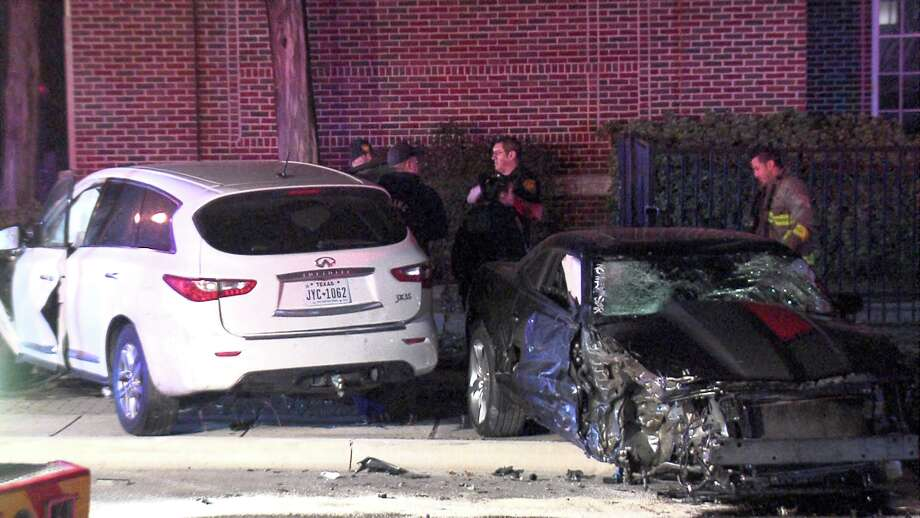 When police arrived to the scene around midnight, they found three vehicles involved in the crash and two injured men. One of the vehicles involved, a red sedan, had crashed through the fence at Mark Twain Middle School. Photo: Ken Branca