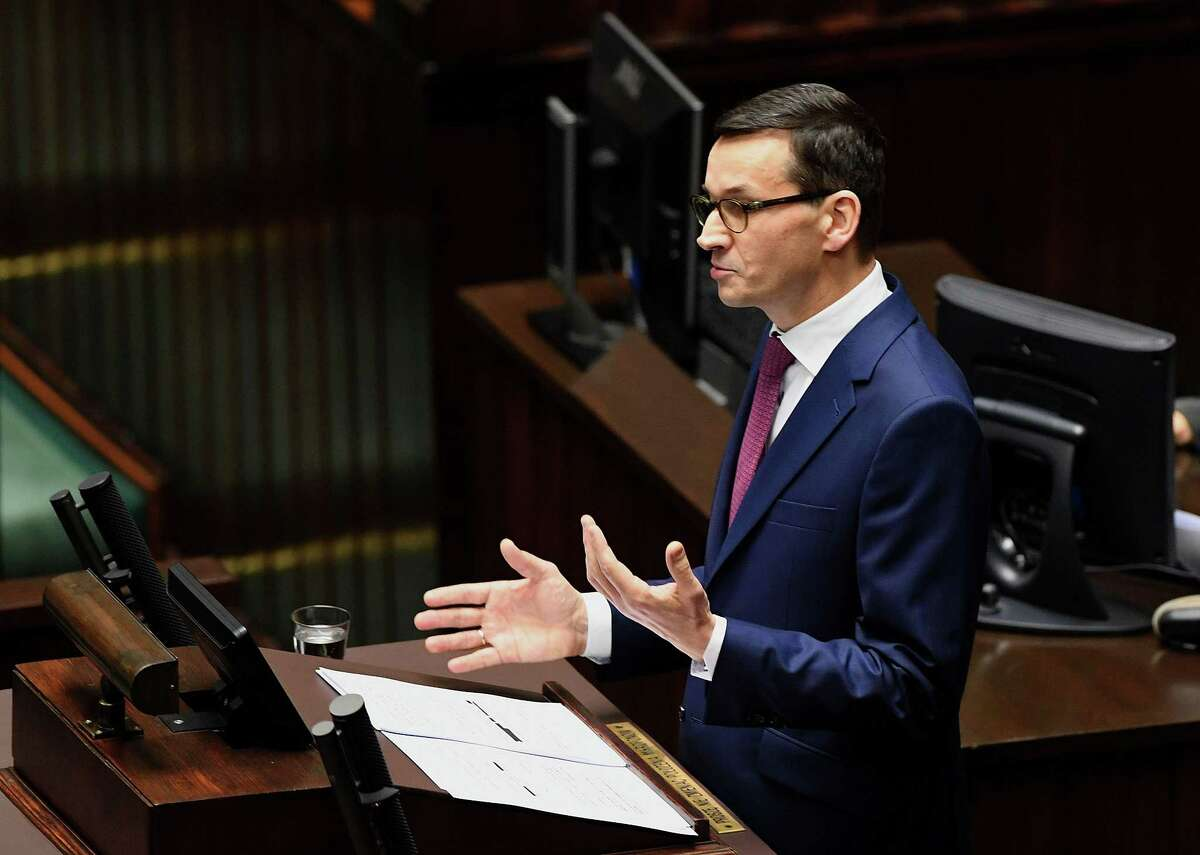 Incoming Polish Prime Minister Mateusz Morawiecki gives a speech to present his programme to lawmakers on December 12, 2017 at the parliament in Warsaw. / AFP PHOTO / JANEK SKARZYNSKIJANEK SKARZYNSKI/AFP/Getty Images