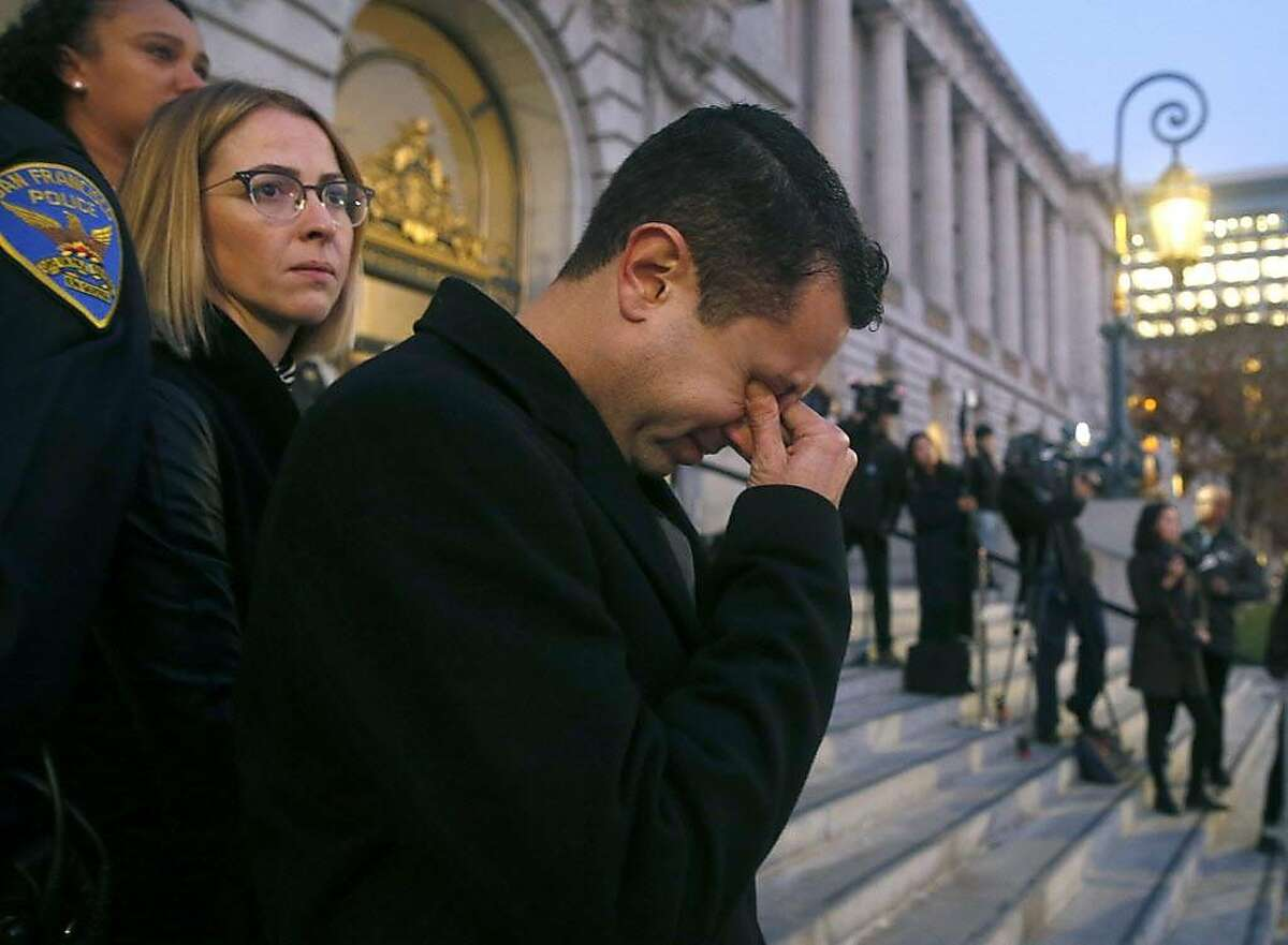 Jason Elliott, Mayor Ed Lee�s chief of staff, wipes tears as the hearse carrying the mayor�s casket arrives at City Hall for a public viewing at City Hall in San Francisco, Calif. on Friday, Dec. 15, 2017. At left is Elliott�s wife Nicole, the head of the city�s Department of Cannabis.