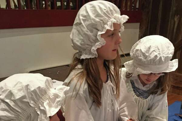 Leila Ward, Kendra Ward and Caroline Gettler get to work on a batch of plum pudding at a recent colonial cooking class at the Wilton Historical Society.