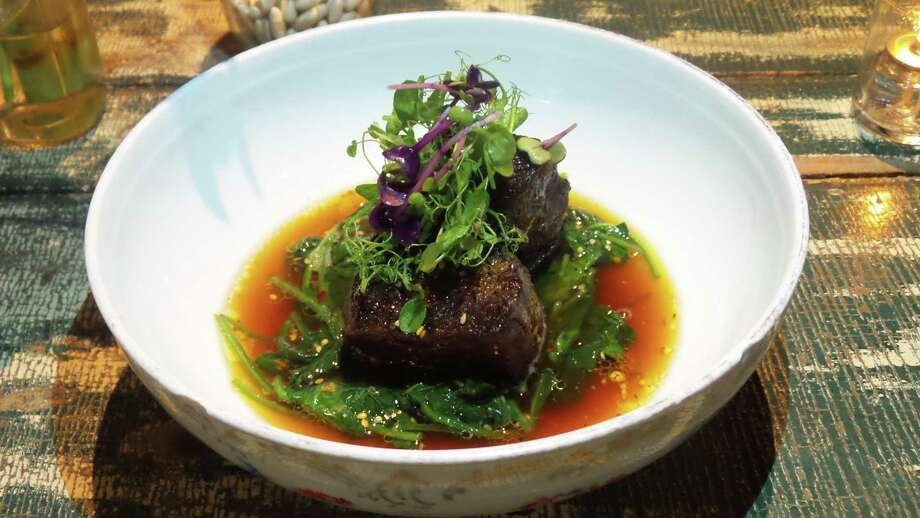 Executive chef Carlos Baez created the recipe for braised short ribs with bonito broth, sautéed spinach and garlic chili oil for the Spread. Photo: MaxEx Public Relations / Contributed Photo