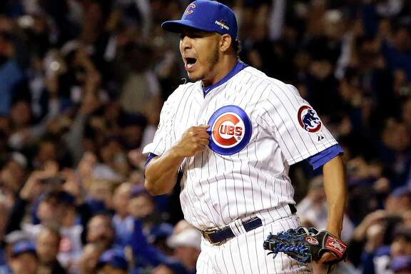 Chicago Cubs relief pitcher Hector Rondon (56) celebrates after striking out St. Louis Cardinals left fielder Stephen Piscotty (55) to win Game 4 in baseball's National League Division Series, Tuesday, Oct. 13, 2015, in Chicago. The Cubs won 4-6. (AP Photo/Nam Y. Huh)