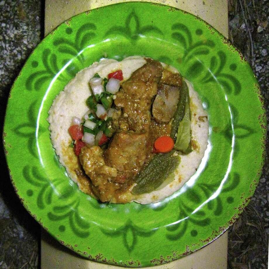 Costillas en salsa verde taco on a handmade corn tortilla from El Original Asadero. Photo: Mike Sutter /San Antonio Express-News