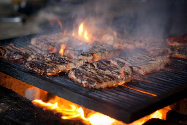 Steaks cooking on a wood grill. David Burke Prime, Foxwoods Resort Casino, Mashantucket New London County Chuck's Steak House and Margarita Grill, Storrs Tolland County Grill 445, Brooklyn Windham County Photo: The Colombian Way Ltda/Getty Images
