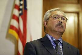 FILE - In this Aug. 15, 2017, file photo, San Francisco Mayor Ed Lee listens to questions during a news conference at City Hall in San Francisco. San Francisco officials will honor the life of Mayor Ed Lee with a memorial celebration Sunday, Dec. 17, 2017, in the rotunda of City Hall. The public will also be able to pay respects Friday as his body lies in state in the rotunda. Lee was 65 years old and the city's first Asian-American mayor. (AP Photo/Eric Risberg, File)