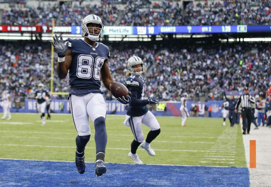 Dez Bryant celebrates his sixth touchdown of the season. Photo: Adam Hunger /Associated Press / FR110666 AP