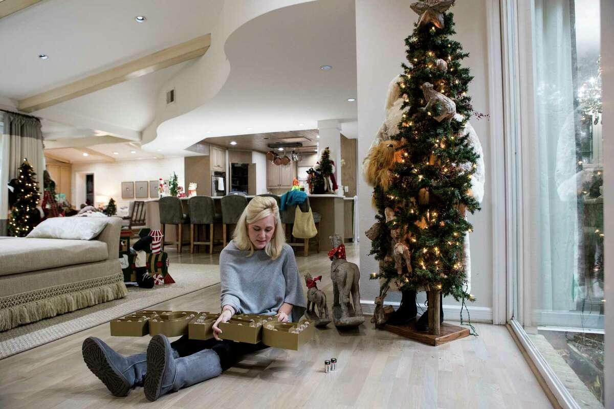 Lauren Leavitt-Griffin's works on her Christmas decorations on Tuesday, Dec. 5, 2017, in Houston. ( Brett Coomer / Houston Chronicle )