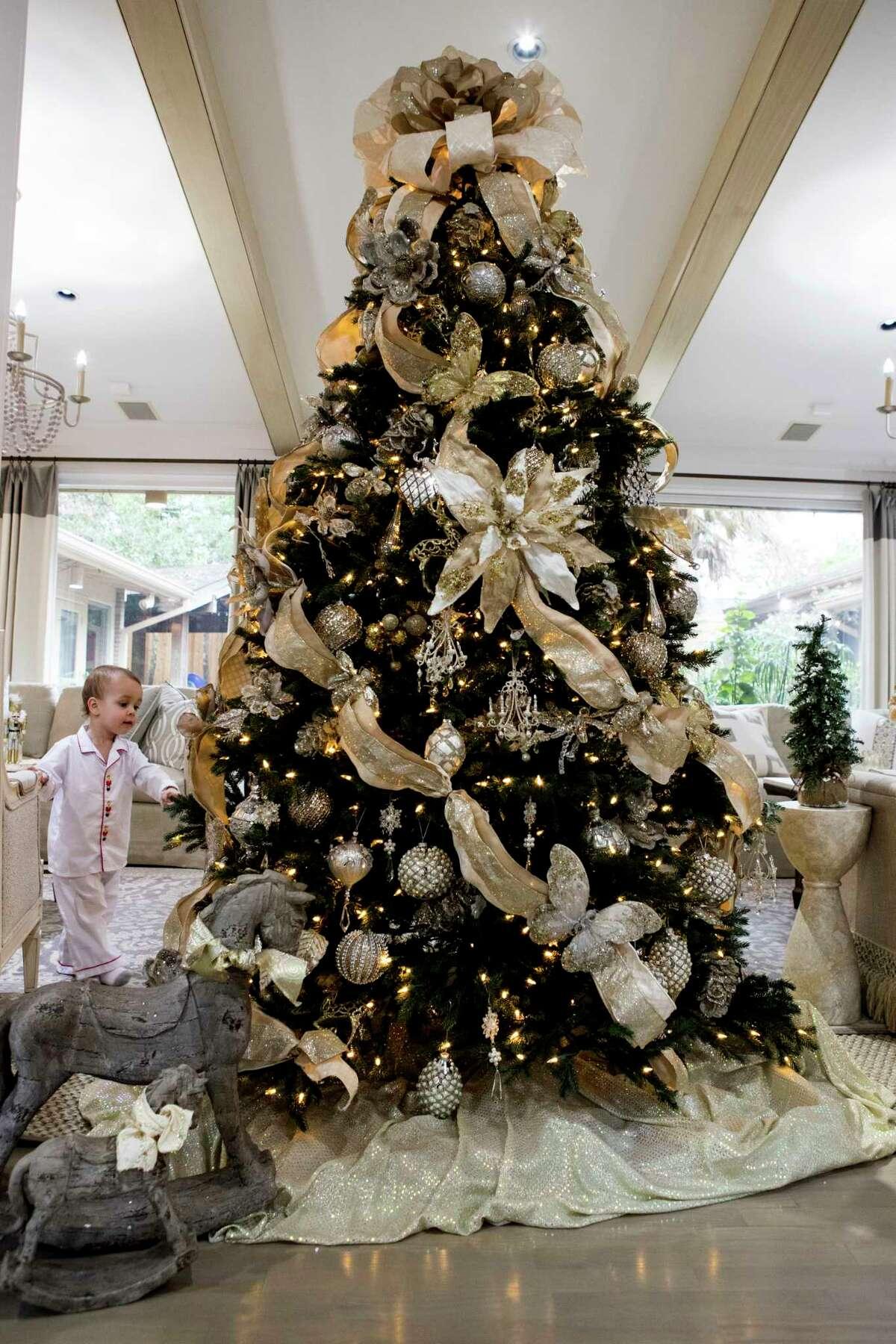 Grant Griffin walks past the family Christmas tree on Tuesday, Dec. 5, 2017, in Houston. ( Brett Coomer / Houston Chronicle )