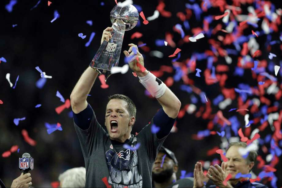 2017 AP YEAR END PHOTOS - New England Patriots' Tom Brady raises the Vince Lombardi Trophy after defeating the Atlanta Falcons in overtime at the NFL Super Bowl 51 football game on Feb. 5, 2017, in Houston. The Patriots defeated the Falcons 34-28. Photo: Darron Cummings, AP / Copyright 2017 The Associated Press. All rights reserved.