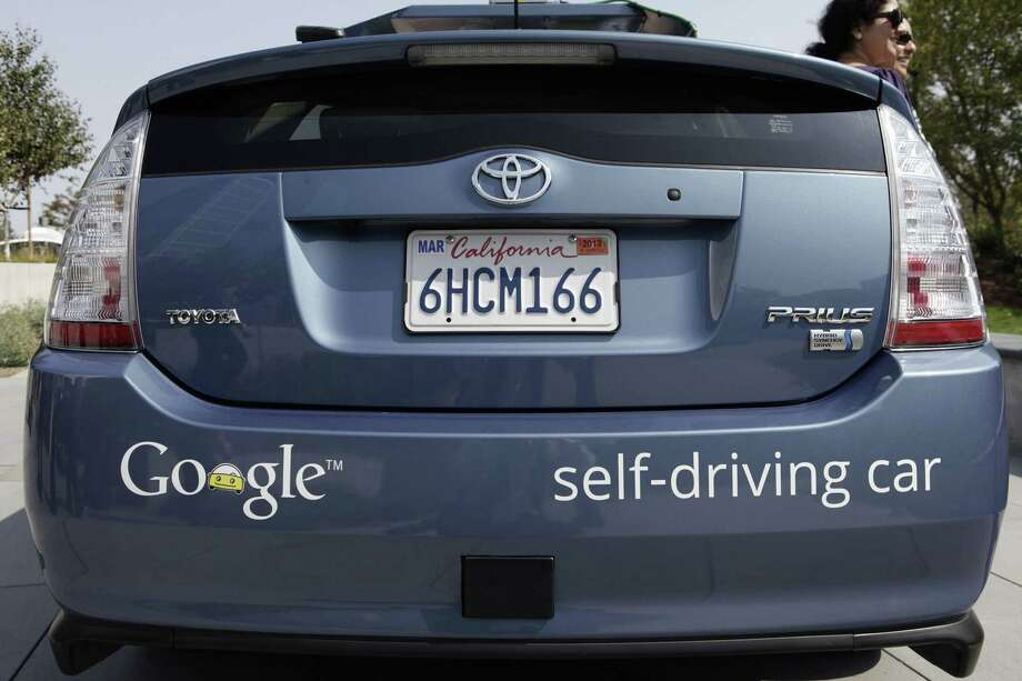 A driverless car is on display at Google Headquarters in Mountain View, Calif., on September 25, 2012. As many as 50 startups are out to get costs for autonomous vehicles way down, along with the research and development departments at automakers and auto industry suppliers, and Silicon Valley giants such as Google and Apple. Photo: Gary Reyes /TNS / Mercury News