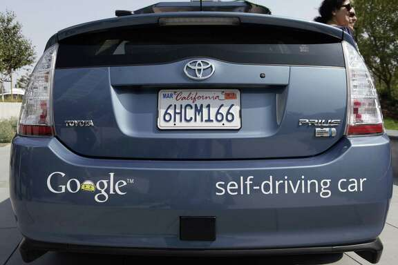 A driverless car is on display at Google Headquarters in Mountain View, Calif., on September 25, 2012. As many as 50 startups are out to get costs for autonomous vehicles way down, along with the research and development departments at automakers and auto industry suppliers, and Silicon Valley giants such as Google and Apple.