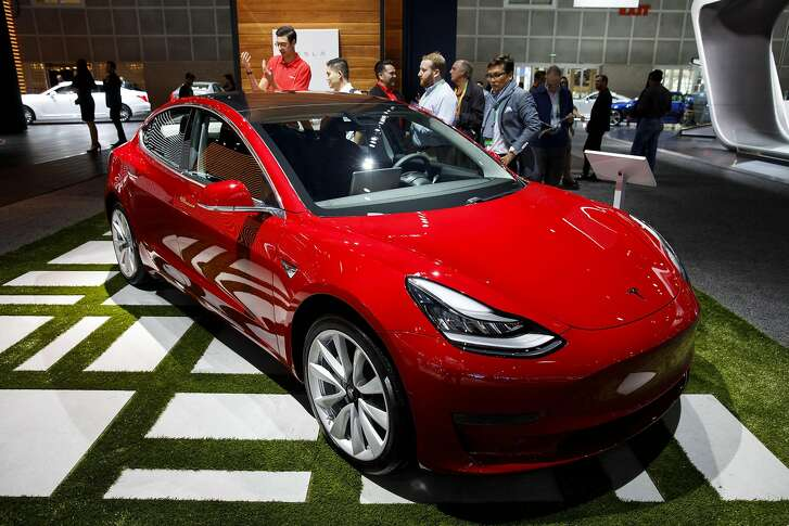 A Tesla Inc. Model 3 vehicle stands on display during AutoMobility LA ahead of the Los Angeles Auto Show in Los Angeles, California, U.S., on Thursday, Nov. 30, 2017. AutoMobility LA brings automakers, tech companies, designers, developers, startups, investors, dealers, government officials and analysts together to unveil the future of transportation with over 50 vehicle debuts. Photographer: Patrick T. Fallon/Bloomberg