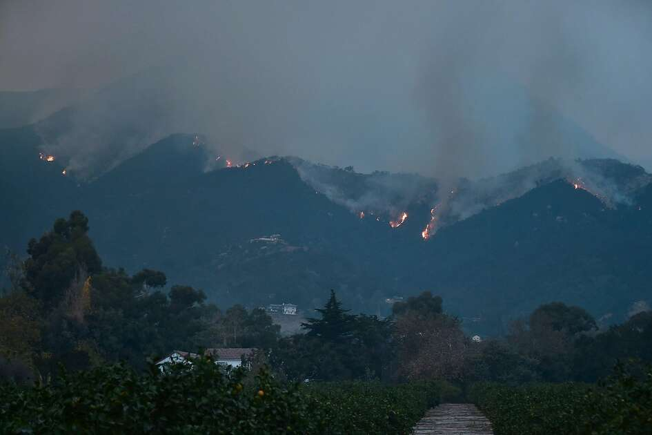 Fires burn across Romero Canyon hillside in Montecito, California, north of Santa Barbara on December 12, 2017. Crews battling wildfires ravaging southern California for a week have managed to slow the spread of the worst of the blazes, officials said, as residents were taking stock of the catastrophic damage. The biggest 'Thomas' fire has charred nearly 95,000 hectares (234,000 acres) of land and is only 20 percent contained, according to the state agency.  / AFP PHOTO / FREDERIC J. BROWNFREDERIC J. BROWN/AFP/Getty Images