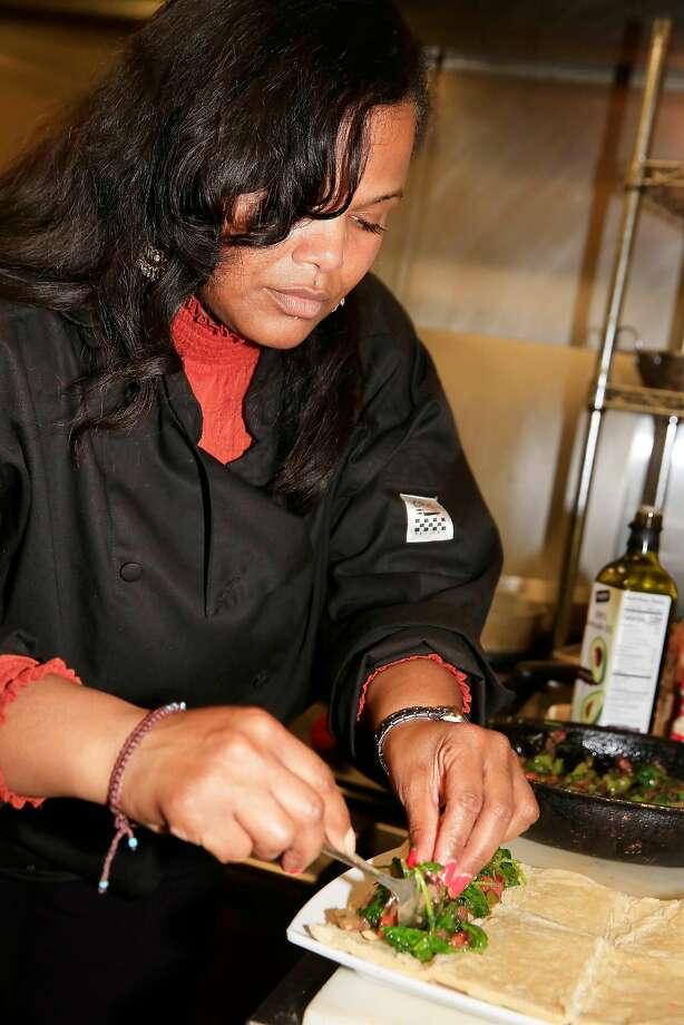 Tamearra Dyson prepares to roll up her vegan Wellington at her restaurant, Souley Vegan. Photo: Lea Suzuki, The Chronicle