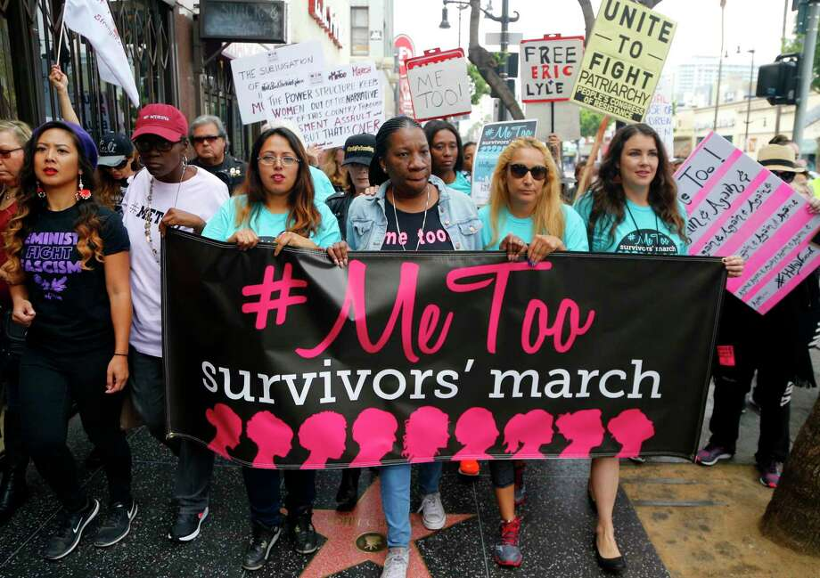 Tarana Burke, center, marches against sexual assault and harassment at the #MeToo March in the Hollywood section of Los Angeles on Sunday, Nov. 12, 2017.  (AP Photo/Damian Dovarganes) Photo: Damian Dovarganes, Associated Press / Copyright 2017 The Associated Press. All rights reserved.