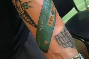 Mikey Rodriguez got the General McMullen exit sign tattooed on his forearm.