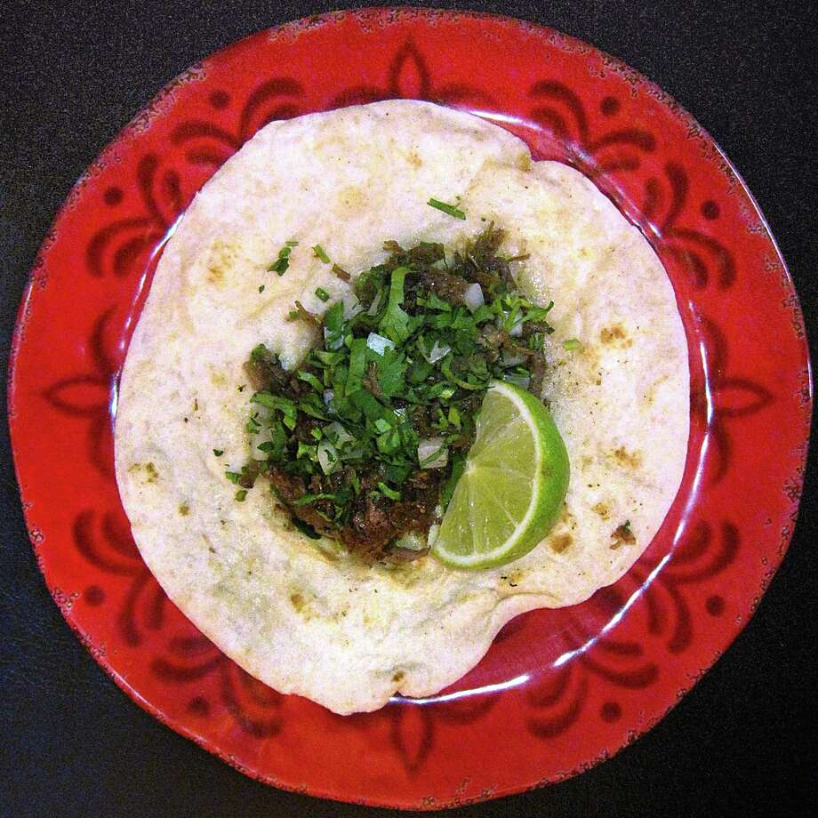 Barbacoa taco on a flour tortilla from Mario's Tacos truck and restaurant. Photo: Mike Sutter /San Antonio Express-News